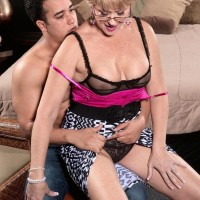 Horny MILF over 50 Tracy Licks seduces a young boy in a skirt and glasses