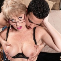 Naughty MILF over 50 Tracy Licks puts the moves on a younger Latino boy