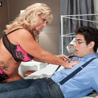 Thick 50 plus MILF Zena Rey seduces a younger nerd in her bra and panties