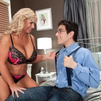 Over 50 MILF Zena Rey seduces a nerdy boy in a matching bra and panty ensemble