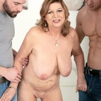 MILF over 60 Brenda Douglas has her large tits played with by two boys at once