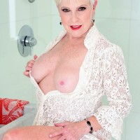 Sexy 60 MILF Jewel wets  and fondles her firm breasts while taking a shower