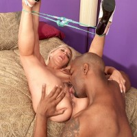Hot 60 plus granny Andi Roxxx has her pussy licked by a younger black man