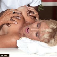 Blonde granny Brittney Snow has her big tits played with by her black masseur