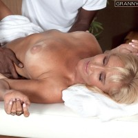 60 plus babe Brittney Snow has her big boobs fondled by younger black masseur
