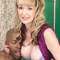 Top granny pornstar Janee Diamond seduces a black man in a short skirt
