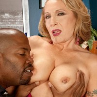 Sexy over 60 MILF Luna Azul has her big tits freed from lingerie by man with a BBC