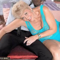 Sexy lady over 60 Tracy Licks seduces a much younger black man in revealing dress