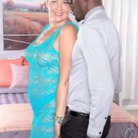 Horny granny Tracy Licks seduces a younger black man in a see thru dress