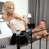 Sexy MILF over 60 Beata seduces a young gentleman in a black skirt and stockings