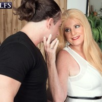 Older blonde woman Charlie has her boobs and nipples sucked by a younger guy
