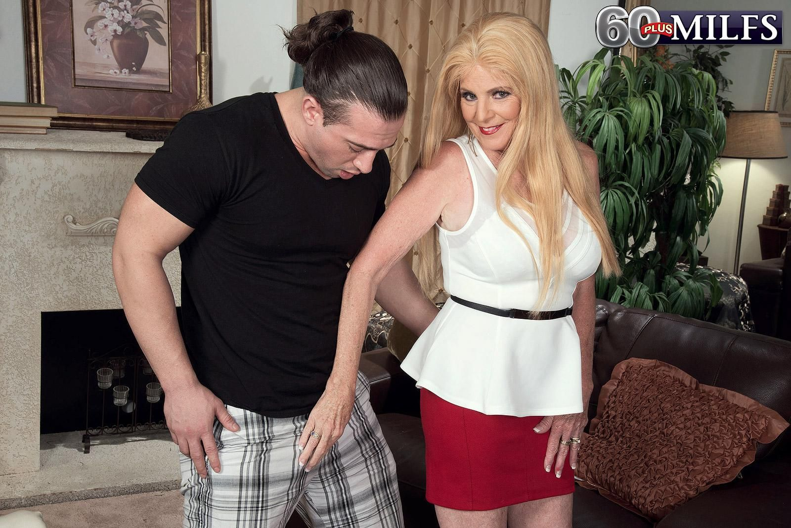 Blonde 60plus MILF Charlie has her big natural tits unleashed by a younger man