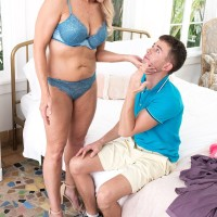 Sexy 60 plus MILF Chery Leigh seduces a young boy in a bra and panty ensemble