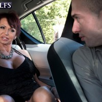 Classy over 60 MILF Gina Milano seduces a younger boy with her round boobs