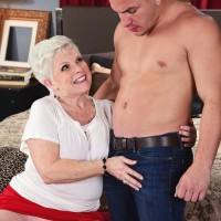 Horny 60 plus MILF Jewel seduces a younger boy in a tight red skirt