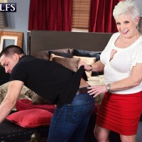 Horny 60 plus MILF Jewel seduces a younger guy while he's moving her furniture