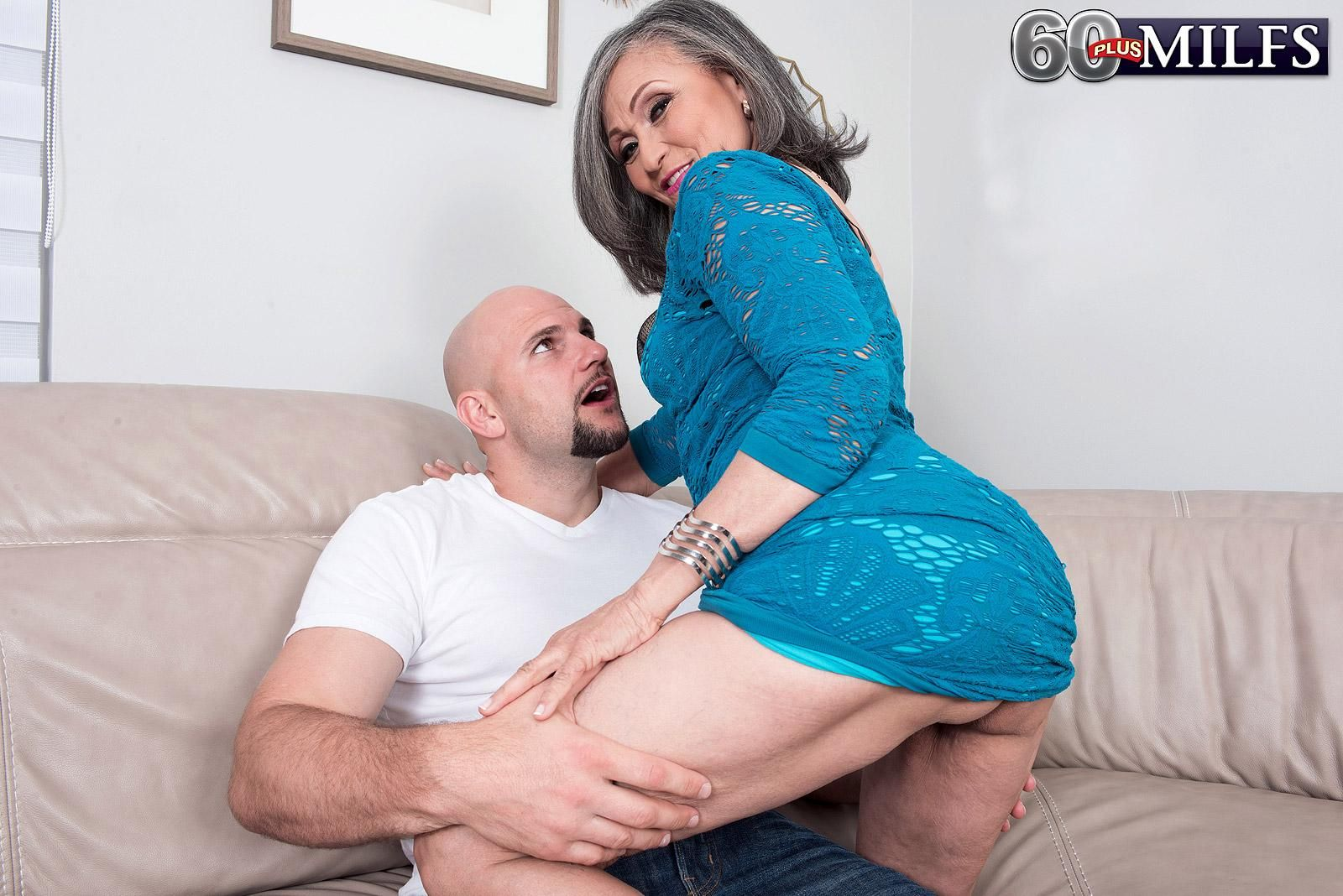 Horny 60+ MILF Kokie Del Coco seduces a younger man in a clingy dress