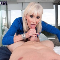 Busty 60 plus lady Leah L'Amour seduces a younger man before sucking his dick