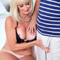 Sexy 60 plus MILF Leah L'Amour blows her young lover while her husband sleeps