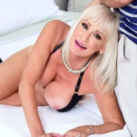 Hot 60 Plus MILF Leah L'Amour undresses before licking a big cock while hubby sleeps