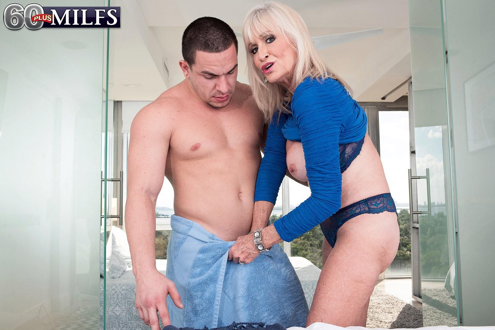 Over 60 MILF Leah L'Amour seduces a younger guy with her big tits