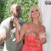 Blonde 60 plus MILF Leah L'Amour seduces a younger guy with her big breasts