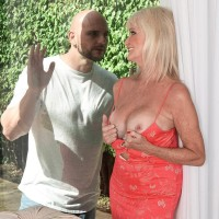 Blonde 60 Plus MILF Leah L'Amour seduces a younger boy with her big boobs
