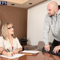Mature MILF Luna Azul welcomes the sexual advances of a younger man in office