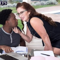 Horny over 60 redhead Maria Fawndeli seduces a younger black boy with a kiss