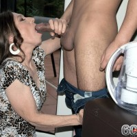 Mature MILF Mona seduces a younger boy outdoors on a hot summer's day