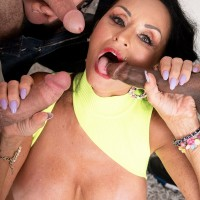 Over 60 pornstar Rita Daniels sucks off big white and black dicks on her birthday