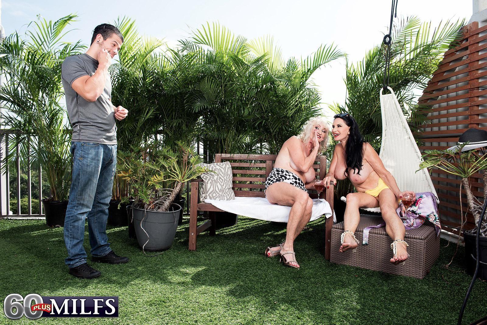 60 plus MILF Rita Daniels and her topless girlfriend lick and jerk a boy's hard cock