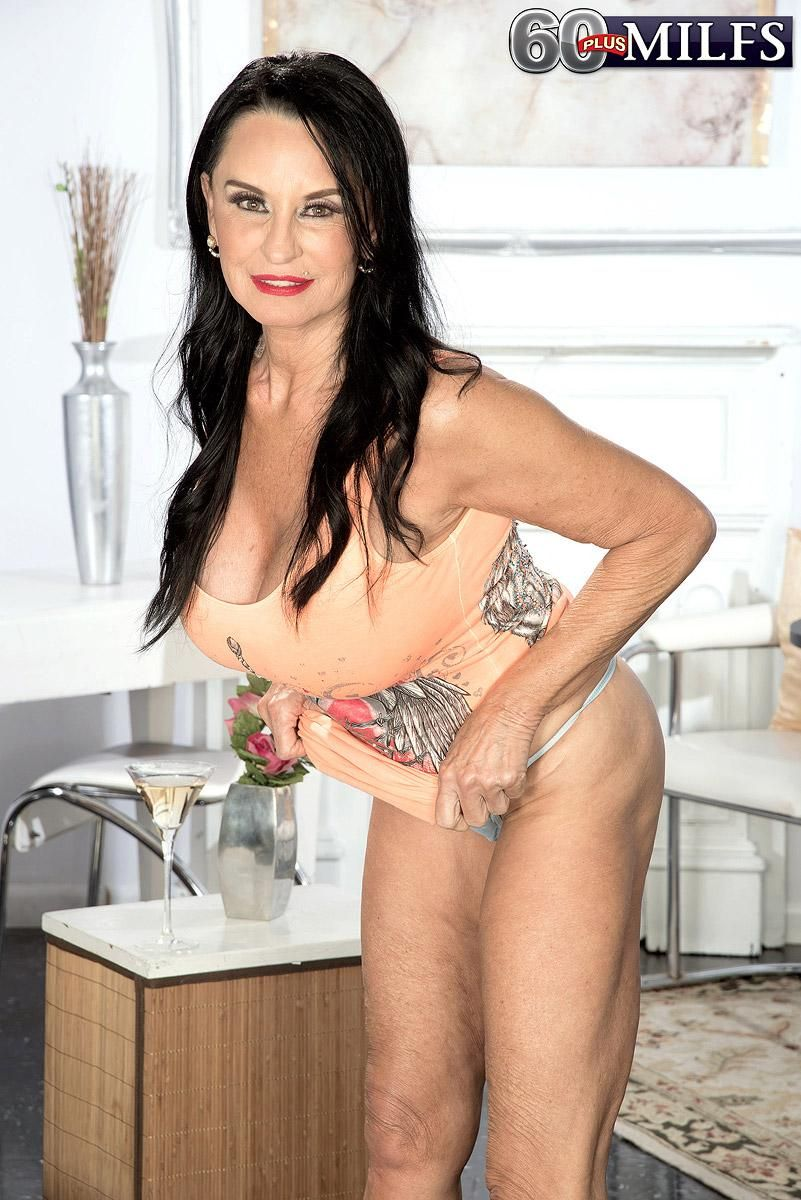 60 Plus MILF Rita Daniels uncovers her large breasts in solo action