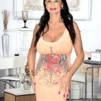Sexy 60 plus woman Rita Daniels frees her large tits from dress in sheer panties