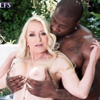 Sexy 60 plus MILF Robin Pachino seduces a black stud on a hot day in lingerie
