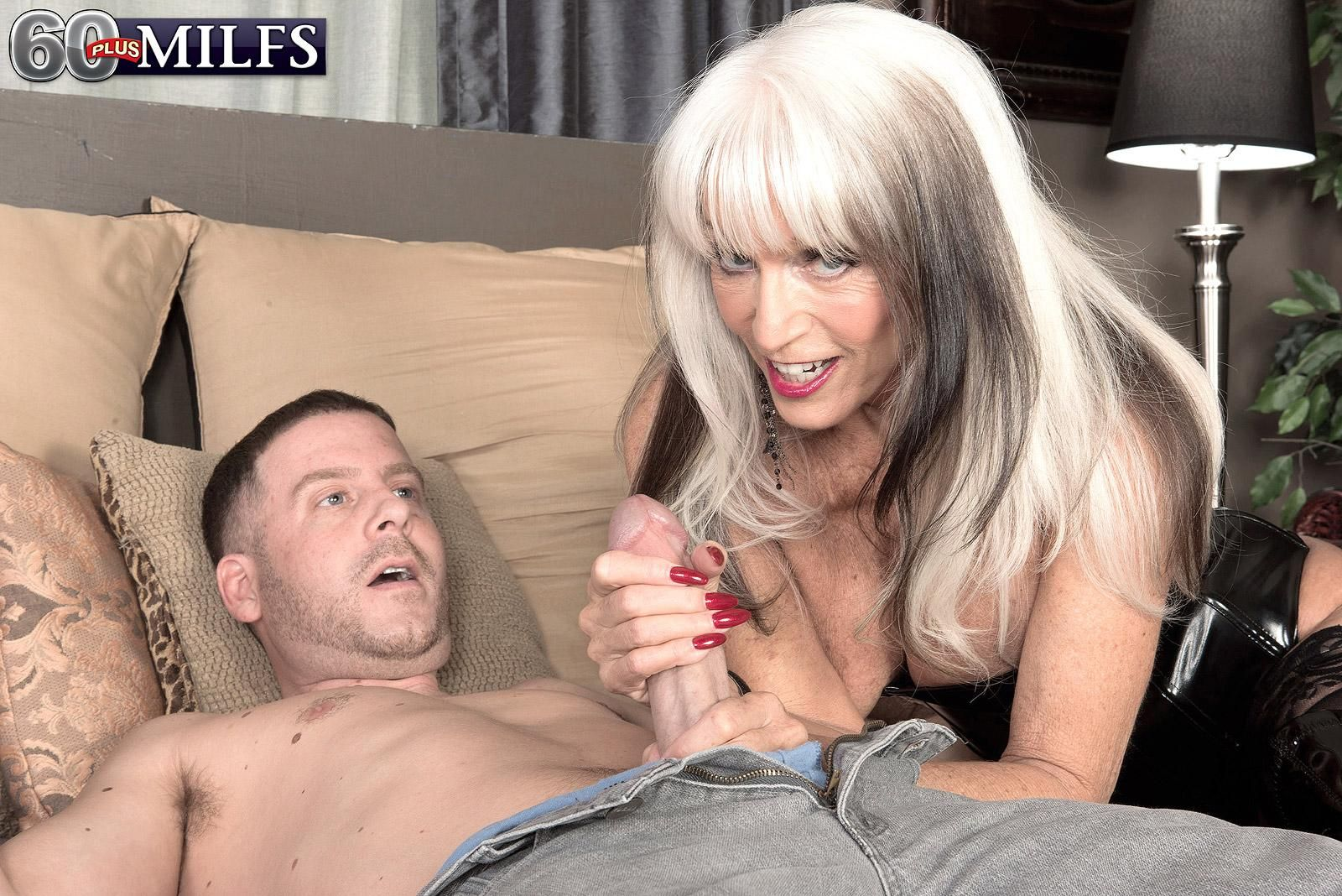 Hot older lady Sally D'Angelo seduces younger man in corset and thigh high boots
