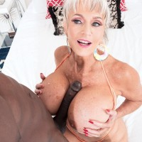 Hot granny Sally D'Angelo has her big tits played with in a hot tub by a black stud