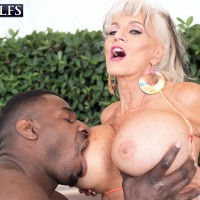 Big titted 60 Plus MILF Sally D'Angelo plays with a black stud in the hot tub