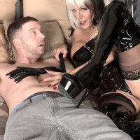 60 plus babe Sally D'Angelo jerks a hard cock in waist cincher and thigh high boots