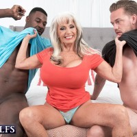 Big titted 60 plus lady Sally D'Angelo pleasures black and white cocks in MMF action