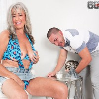 Beautiful 60 plus MILF Silva Foxx seduces a young man in swimwear and shorts