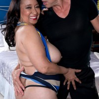 Aged black-haired doll Rochelle Alluring revealing large all natural funbags for nipple sucking