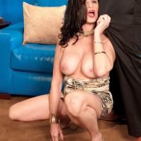 Aged dark-haired X-rated starlet Rita Daniels revealing huge tits before bi-racial sex