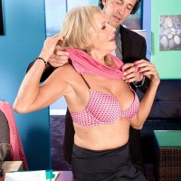 Big-chested light-haired MILF over 60 Bethany James delivering massive junk blow-job in office