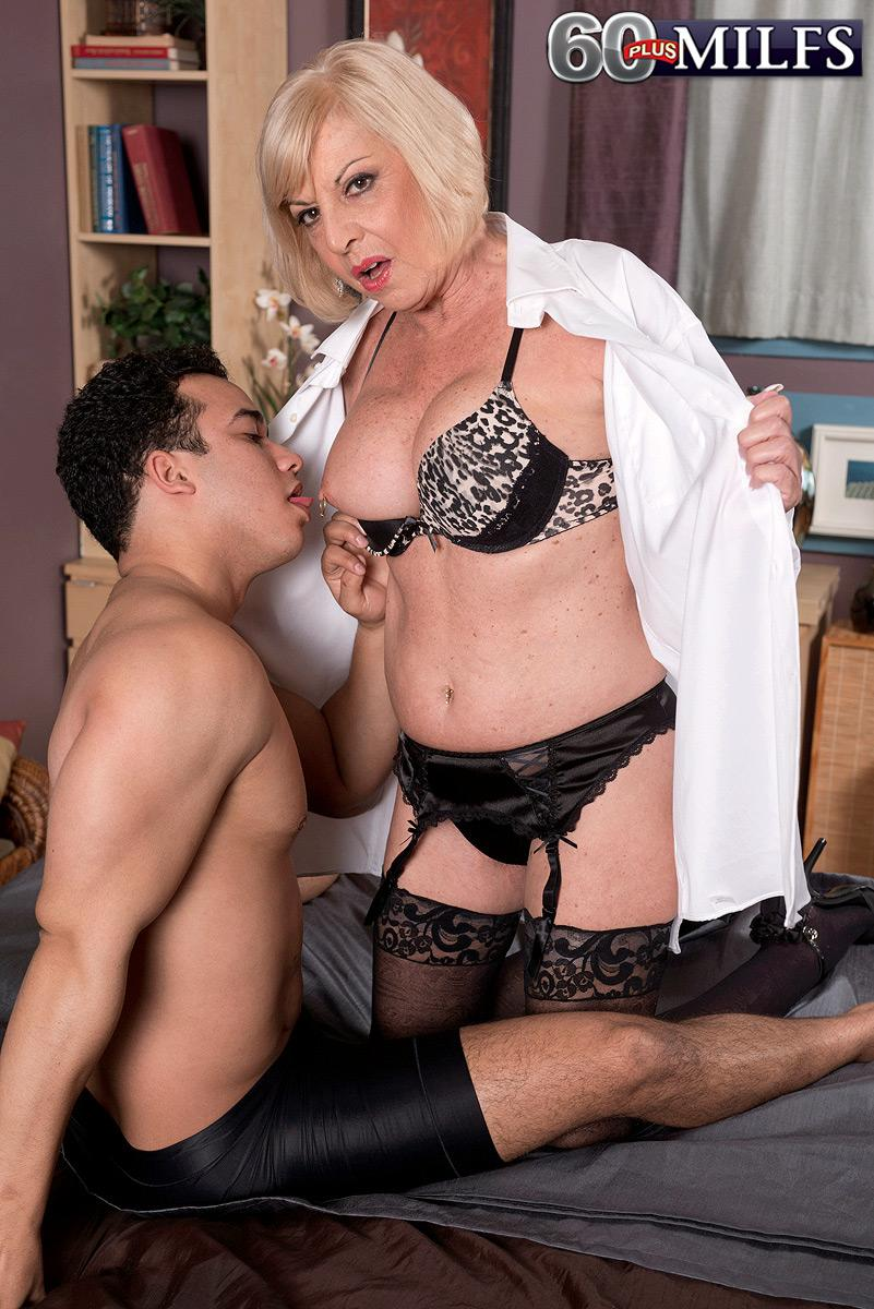 Big-chested light-haired sixty plus MILF Scarlet Andrews having nipples blown and taunted