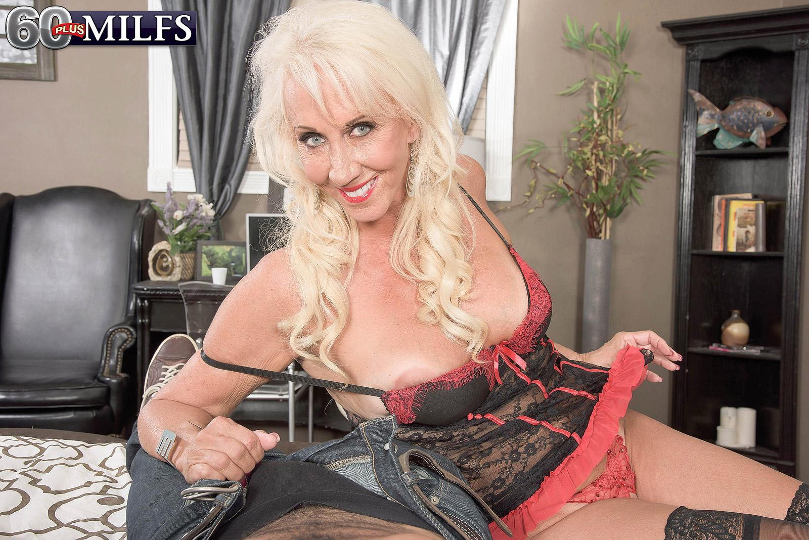 Big-chested lingerie adorned mature porno star Madison Milstar milking prick in nylons