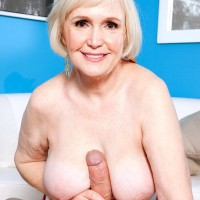 Big-chested short haired grandmother Lola Lee providing huge knob blow job and titty fucking in tights