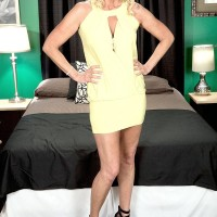 Ash-blonde grannie Nikki Chevious works on seducing a ebony stud in a yellow sundress