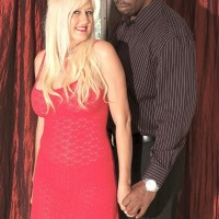 Blonde granny Marina Johnson greets her black lover in red dress and matching heels
