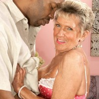 Bosomy stocking and lingerie clad seventy plus grannie Sandra Ann giving giant black boner a oral job